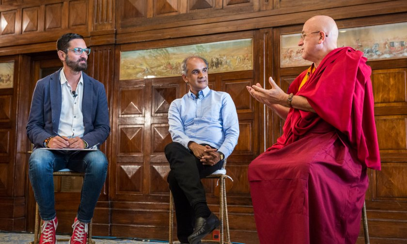Guy Raz (left), Pico Iyer (center), and Matthieu Ricard (right) discuss mindfulness and the importance of being still at TED Global 2014 . Photo by Duncan Davidson/TED.